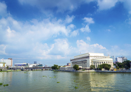 philippines: national post office building and river in manila philippines