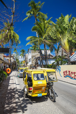 trike moto taxis traffic on boracay island main road in philippines
