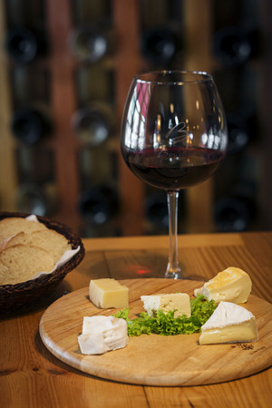 cheese platter: mixed traditional french cheese platter with bread and wine
