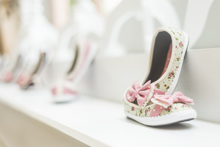 footwear: young girls shoes in childrens footwear fashion shop display Stock Photo