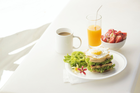fruits juice: egg and salad sandwich with fruit salad juice and coffee breakfast set
