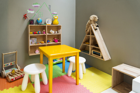 children kids play area with toys and furniture