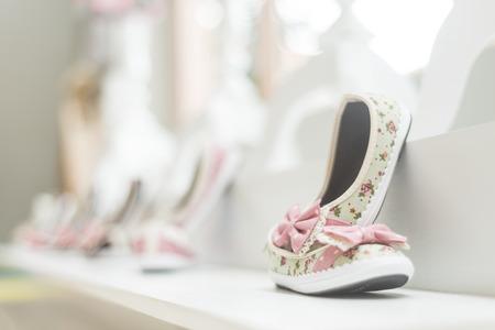 footwear: young girl shoes in children footwear shop display