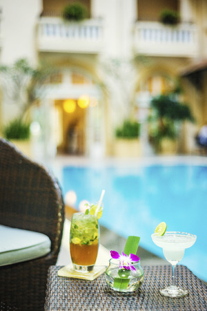 pool side: stylish cocktails in exotic elegant classic tropical pool side bar