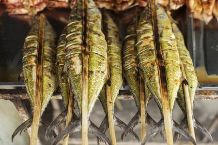 fish vendor: fresh grilled bbq asian fish in kep market cambodia Stock Photo