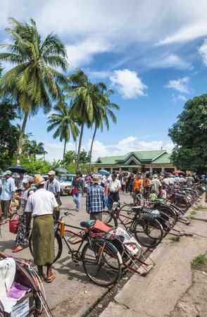 rikscha: old bicycle cyclo taxi rickshaw in yangon myanmar ferry port
