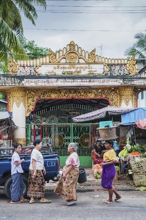 streetscene: street market in yangon myanmar outside buddhist burmese temple
