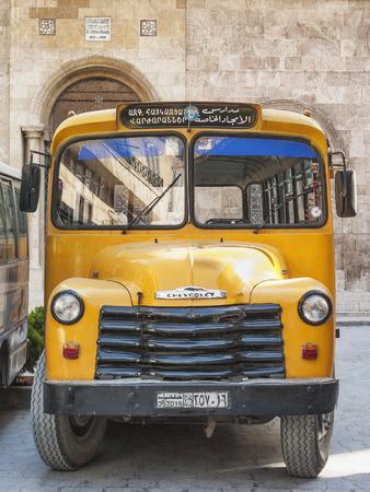 chevrolet: vintage armenian school yellow chevrolet  bus in aleppo old town syria
