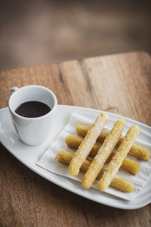 churros: chocolate and churros traditional spanish breakfast snack food Stock Photo