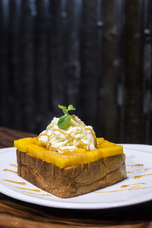 fusion: gourmet fusion french toast with mango and whipped cream