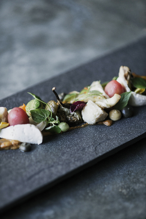 food  restaurant: gourmet cuisine goat cheese fig and vegetable salad