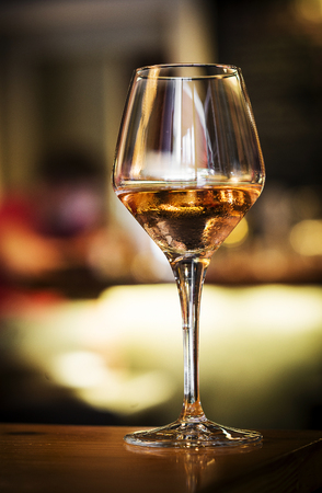 sherry: glass of spanish sherry wine on bar counter at night Stock Photo