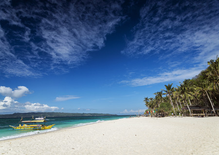 tour boats: traditional filipino asian ferry taxi tour boats on puka beach in tropical boracay philippines