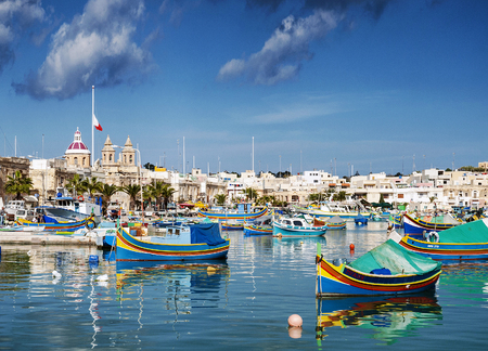 marsaxlokk harbour and traditional mediterranean fishing boats in malta island