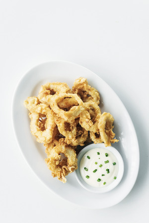 calamares: traditional spanish fried calamari squid rings tapas with aioli garlic sauce
