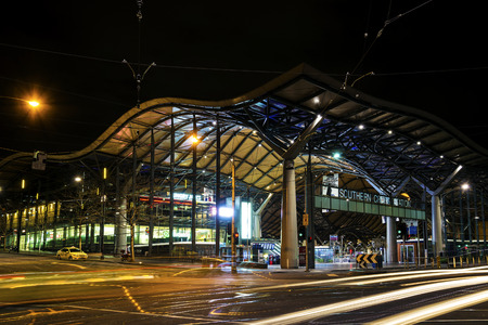 rail cross: southern cross rail station exterior in central melbourne australia at night Editorial