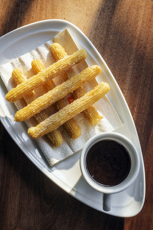 churros: churros and chocolate spanish donuts pastry doughnuts with sauce breakfast snack