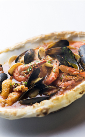 mussels shrimp and fish seafood and spicy tomato puttanesca marinara pasta Stock Photo