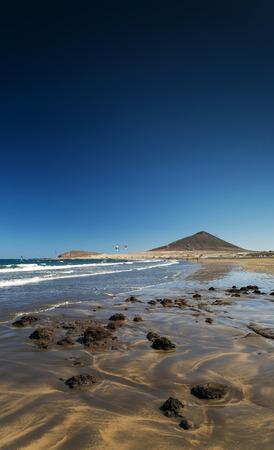 kite surfing: la tejita kite surfing beach and montana roja landmark in south tenerife spain