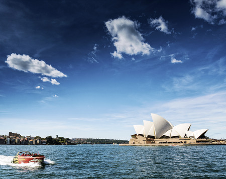 famous sydney landmark opera house view with speed boat in australia on sunny day Editorial