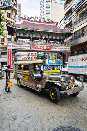 jeepney and busy street urban traffic in central manila city chinatown philippines Editorial