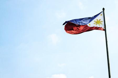 flagpole: philippines filipino flag flying on flagpole in manila Stock Photo