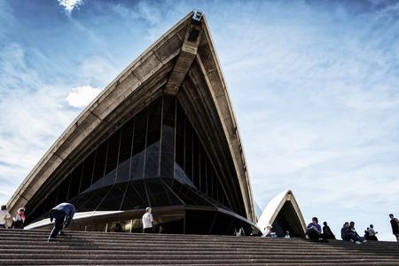 sydney opera house: tourists visiting sydney opera house landmark detail in australia on sunny day