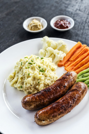 german sausage: german sausage with mashed potato and vegetables simple meal Stock Photo