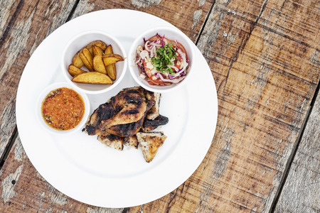 piri piri: piri piri portuguese roast chicken with african jindungo spicy sauce meal Stock Photo