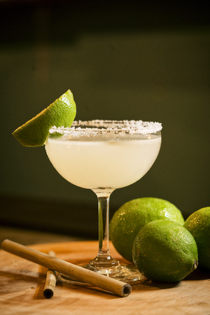chic: mexican lemon lime margarita tequila cocktail drink in modern bar