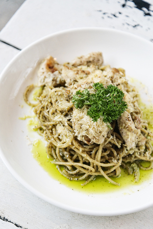italian food chicken and cheese spaghetti with pesto sauce meal