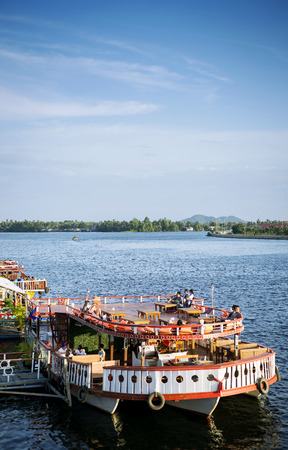 view of river boat tourist restaurants in kampot town cambodia