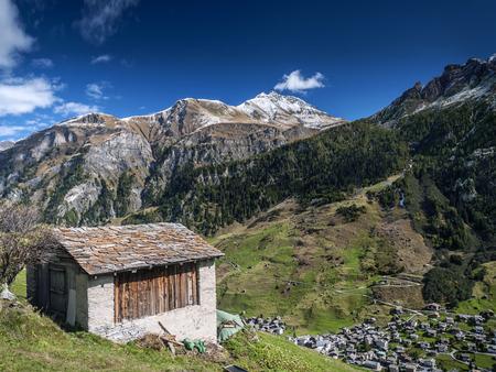 vals village alpine valley landscape and homes in central alps switzerland Editorial