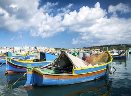 maltese traditional colorful painted luzzu boats in marsaxlokk fishing village malta Editorial
