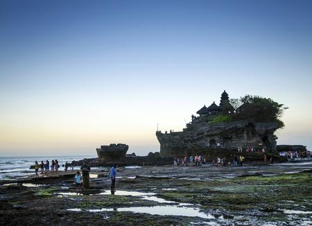 pura Goa Lawah hindu temple sunset backlight silhouette in bali indonesia
