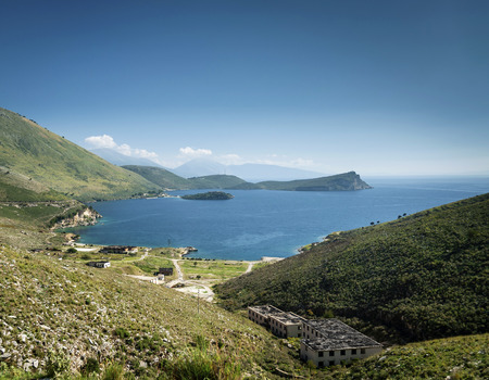 ionian mediterranean sea coast landscape of Southern Albania north of Sarande on road to Vlore with old military base ruins