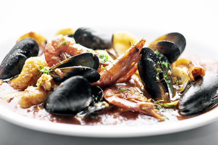 sicilian mixed fresh seafood stew with prawns mussels scallops and clams in spicy tomato sauce