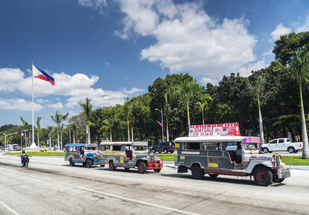 jeepney bus local transport traffic in downtown manila city street in philippines Stock Photo - 120227409