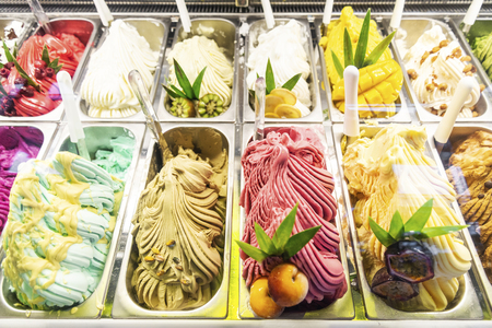 various italian gelato ice cream flavours in modern shop display window