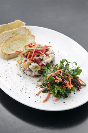 raw marinated sea bass fish ceviche salad modern gourmet fusion cuisine starter set in melbourne australia restaurant