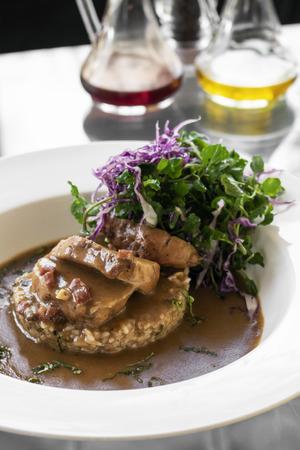 portuguese pork steak in creamy spicy chorizo sausage gravy sauce  modern cuisine