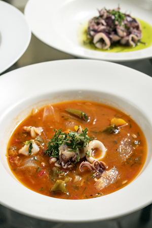 caldeirada de lulas squid seafood stew soup in spicy tomato and vegetable sauce in lisbon restaurant Reklamní fotografie
