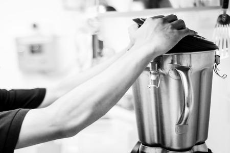 making gelato ice cream with modern professional equipment preparation detail in kitchen interior black and white photo Imagens