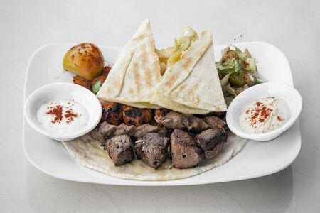 lebanese meshwi mixed bbq grilled meat set with chicken, lamb and beef in beirut restaurant