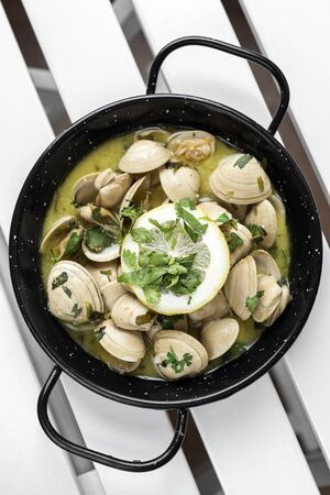 sauteed fresh clams tapas in lemon garlic parsley sauce in santiago de compostela spain