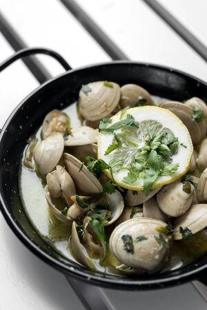 sauteed fresh clams tapas in lemon garlic parsley sauce in santiago de compostela spain