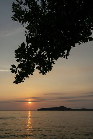 view from Koh Ta Kiev island  towards Koh Russei near Sihanoukville in Cambodia at sunset Stock Photo