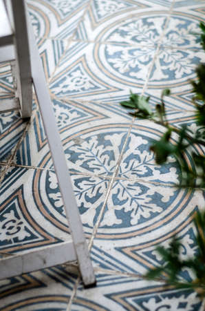 traditional design old rustic floor tiles detail in seville andalucia cafe