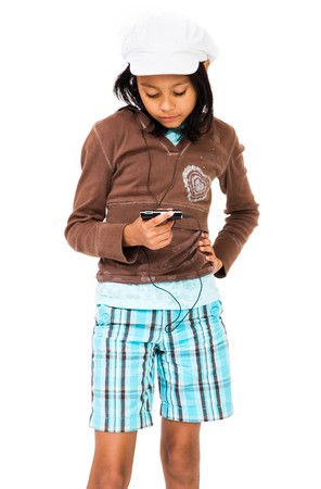 Girl listening to MP3 player with her hand on hip isolated over white Stock Photo - 4568588