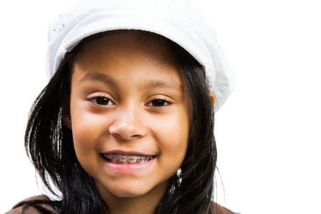 Latin American and Hispanic girl smiling isolated over white Stock Photo